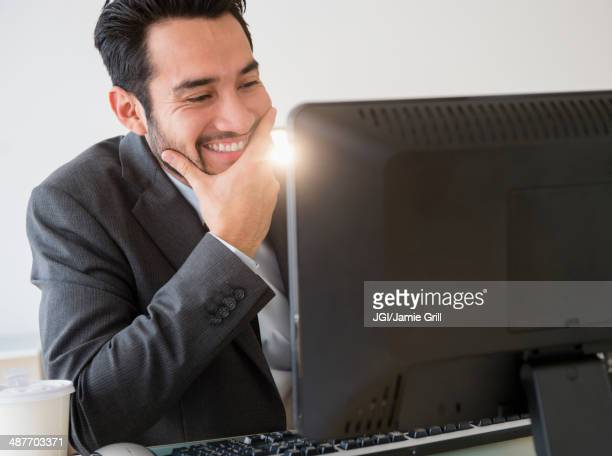 Mixed race businessman working in office