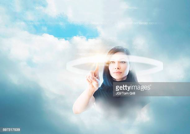 Mixed race businesswoman in clouds