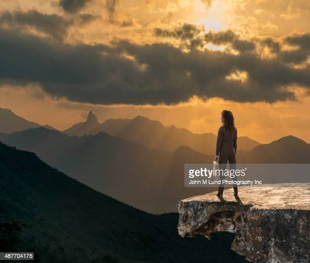 Mixed race businesswoman overlooking rocky landscape