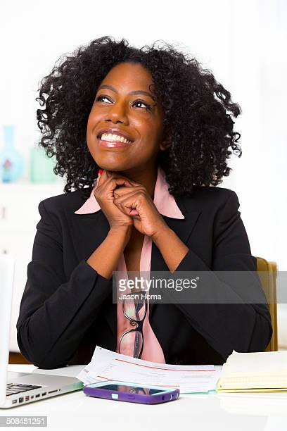 Mixed race businesswoman sitting at desk