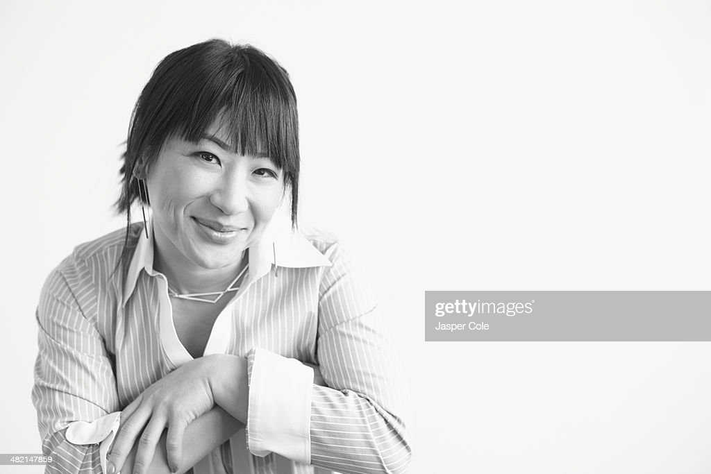 Mixed race businesswoman smiling : Stock Photo