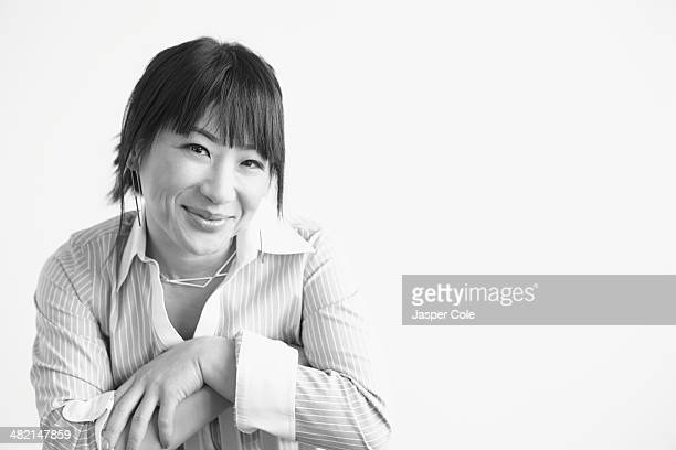 mixed race businesswoman smiling - black and white stock pictures, royalty-free photos & images