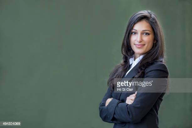 Mixed race businesswoman smiling
