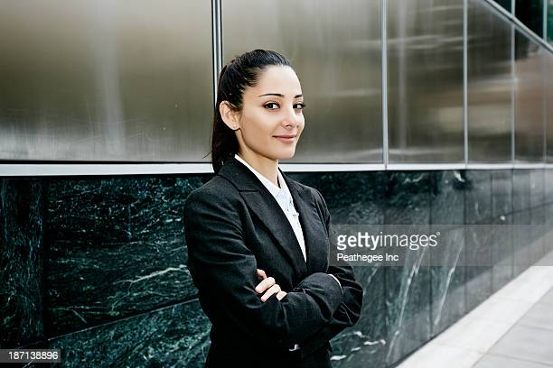 Mixed race businesswoman standing outdoors