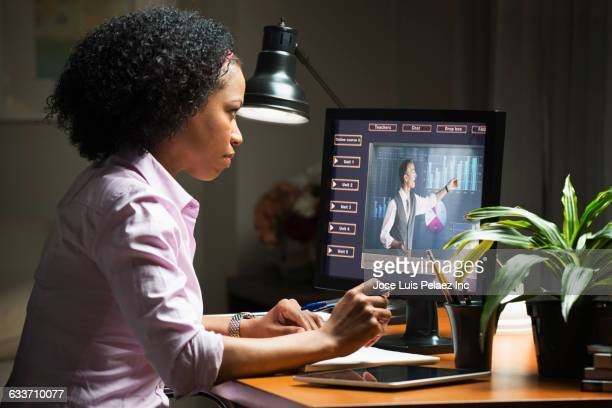 mixed race businesswoman taking online class on computer - online class stock pictures, royalty-free photos & images