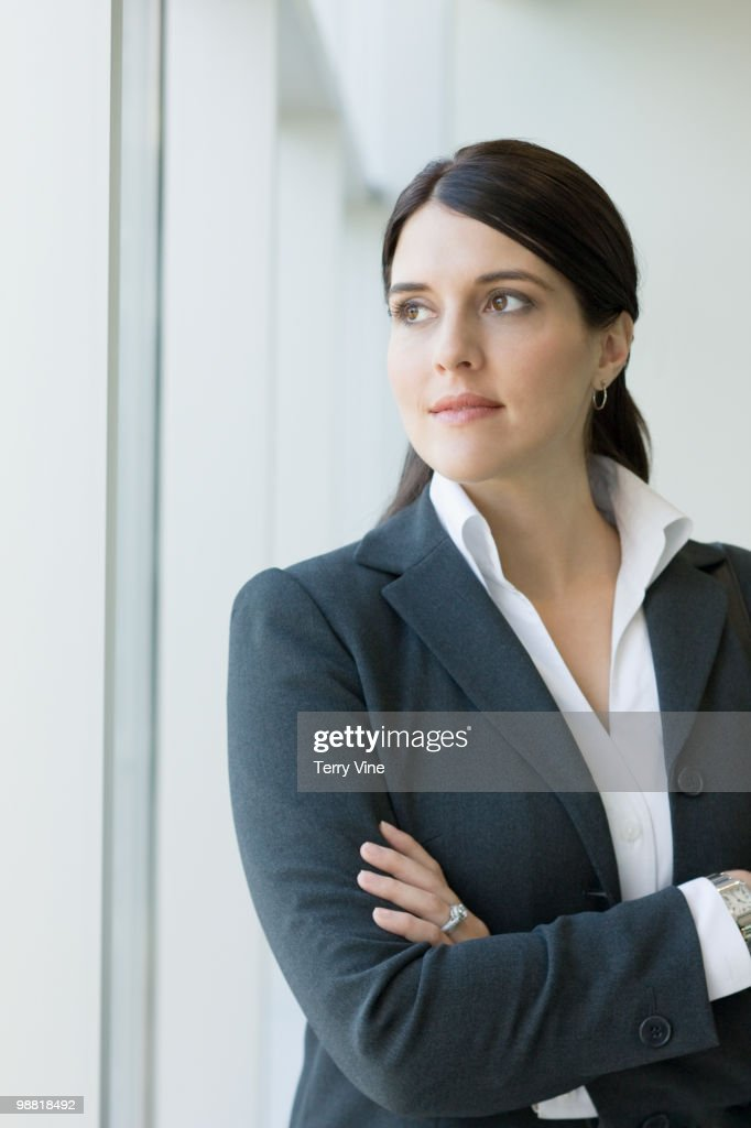 Mixed race businesswoman with arms crossed : Stock Photo