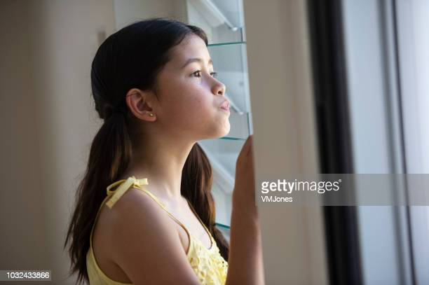 Mixed Race Child looking out the window