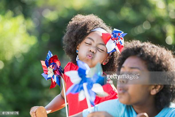 Mixed race children celebrating American patriotic event