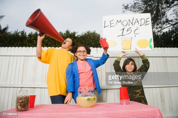 Mixed Race children selling lemonade