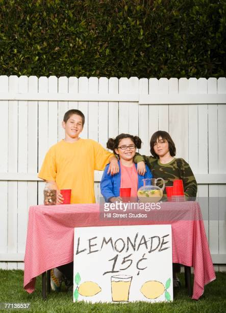 Mixed Race children selling lemonade