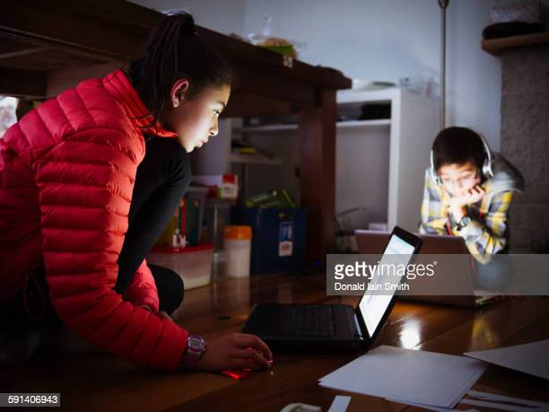 mixed race children using laptops on floor - palmerston north new zealand stock pictures, royalty-free photos & images