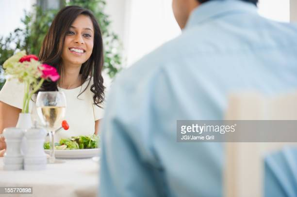 Mixed race couple dining together