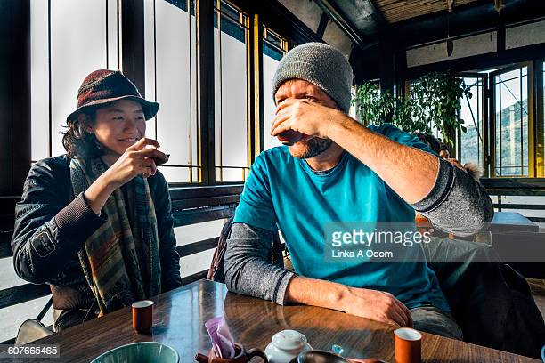 Mixed race couple drinking tea