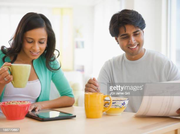 Mixed race couple eating breakfast