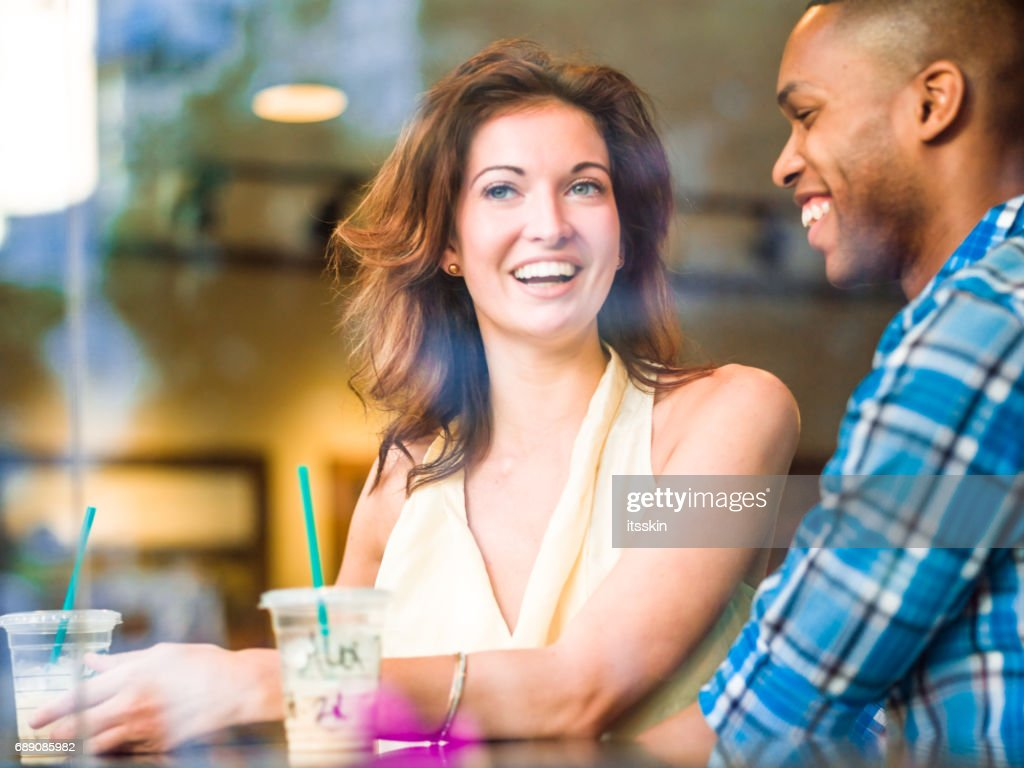 Mixed race couple in NYC cafe : Stock Photo