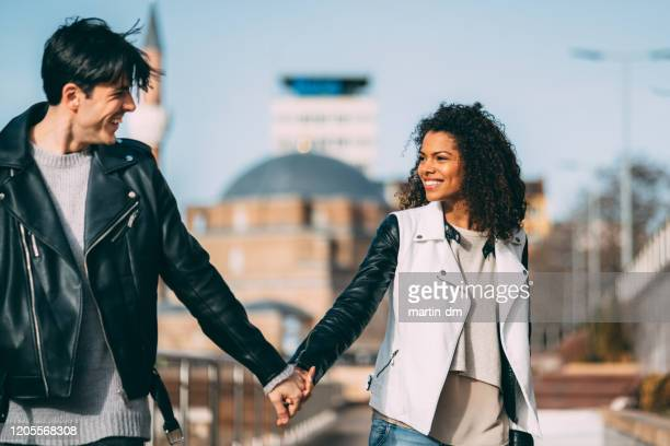mixed race couple outside - martin dm stock pictures, royalty-free photos & images