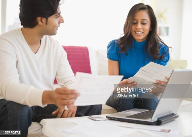 Mixed race couple paying bills online