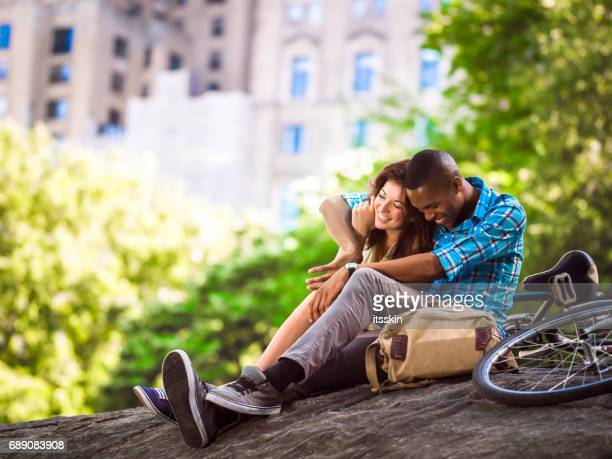 Mixed race couple relaxing in Central Park, New York