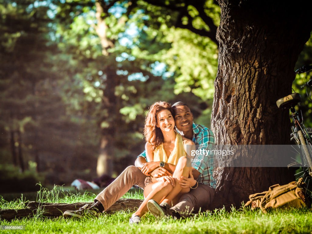 Mixed race couple relaxing in Central Park, New York : Stock Photo