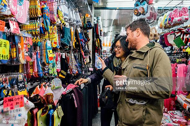 Mixed race couple shopping in Asian Market