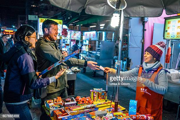 Mixed race couple shopping in outdoor Asian Market