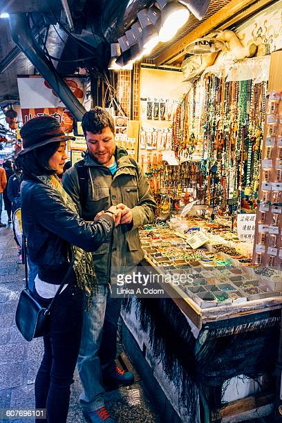 Mixed race couple shopping open air Asian Market
