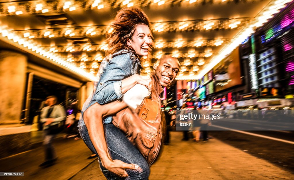 Mixed race couple walking around in New York City : Stock Photo
