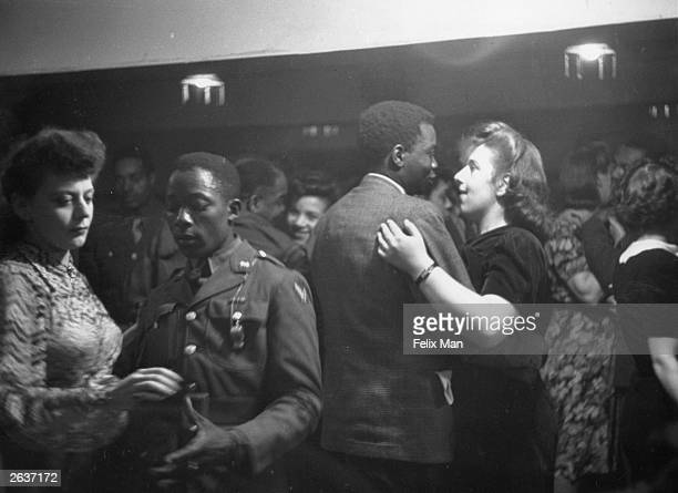 Mixed race couples dancing in a London club, 1943. Original Publication: Picture Post - 1486 - Inside London's Coloured Clubs - pub. 1943
