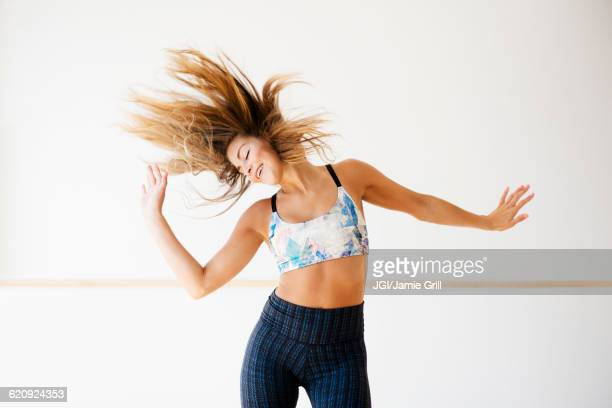 mixed race dancer practicing in studio - dance studio stock pictures, royalty-free photos & images