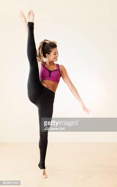 Mixed race dancer practicing in studio