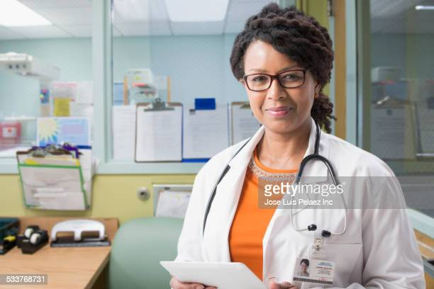 Mixed race doctor smiling in hospital