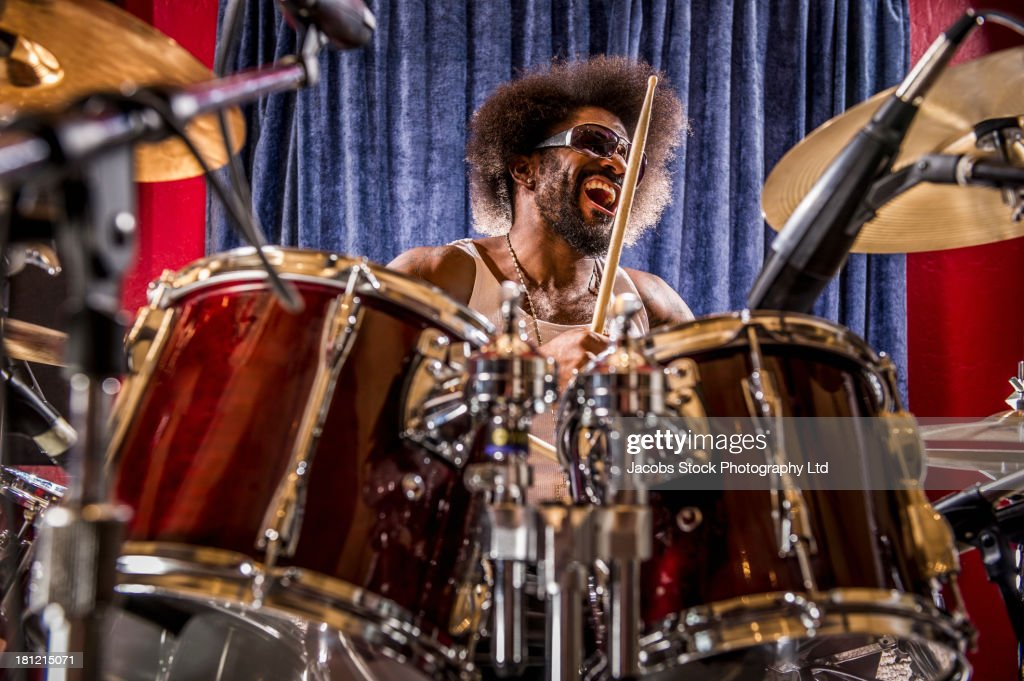 Mixed race drummer performing : Stock Photo