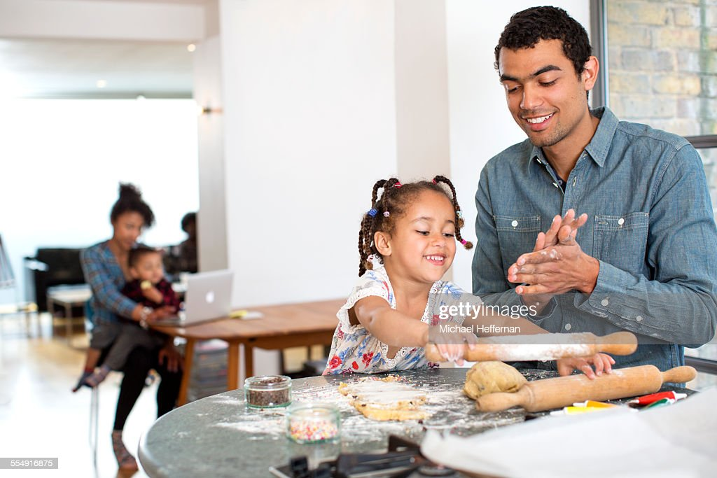 Mixed race family at home together : Stock Photo