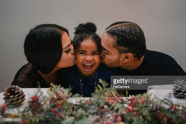 mixed race family celebrates the holidays - afro caribbean ethnicity stock pictures, royalty-free photos & images