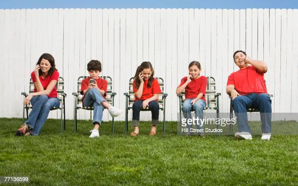 Mixed Race family talking on cell phones