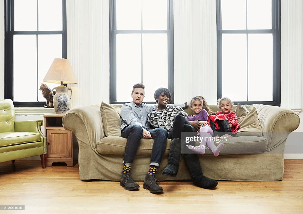 Mixed race family w/ transgender dad and daughters : Stock Photo