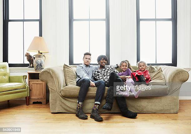 mixed race family w/ transgender dad and daughters - ftm stock photos and pictures