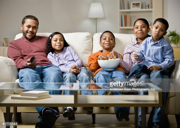Mixed Race family watching movie