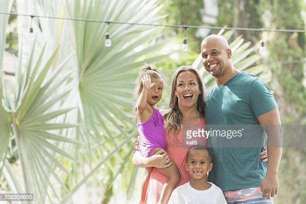 Mixed race family with children on tropical vacation