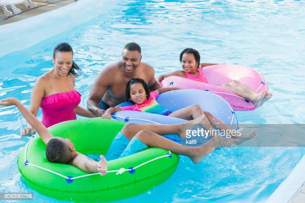 Mixed race family with three children at water park