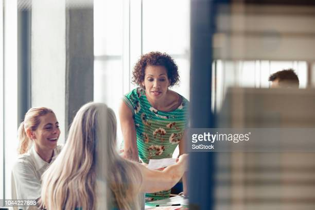 mixed race female team leader - opportunity stock pictures, royalty-free photos & images