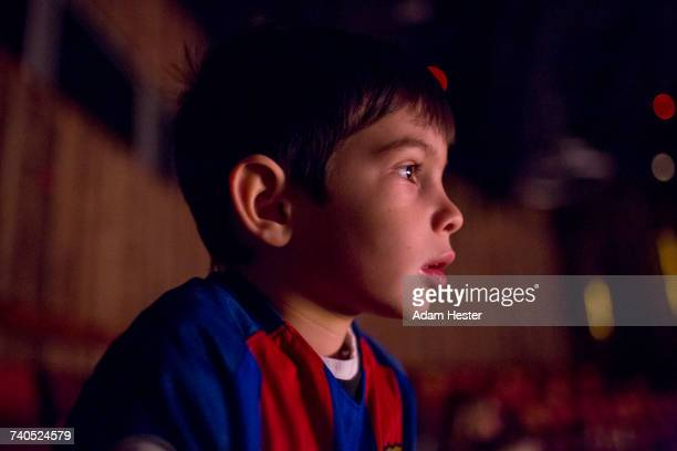 mixed race girl boy watching movie in theater - children theatre stock photos and pictures