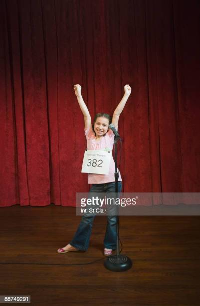 Mixed race girl competing in spelling bee