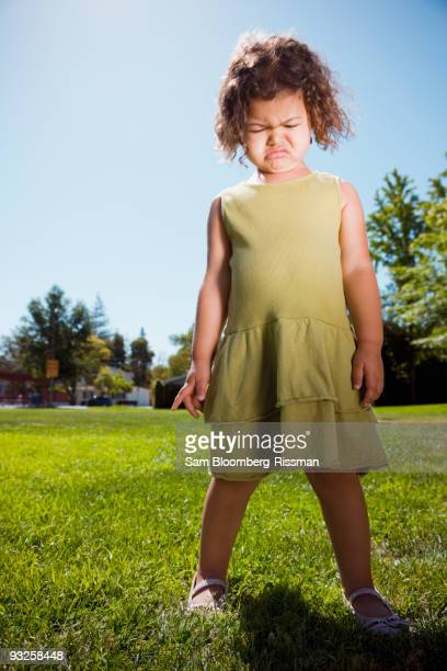 mixed race girl crying in park - tantrum stock photos and pictures