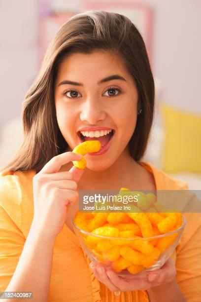 Mixed race girl eating snack