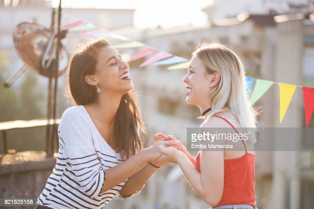 Mixed race girl friends laughing together