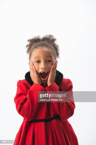 mixed race girl gasping in dress coat - frock coat stock pictures, royalty-free photos & images