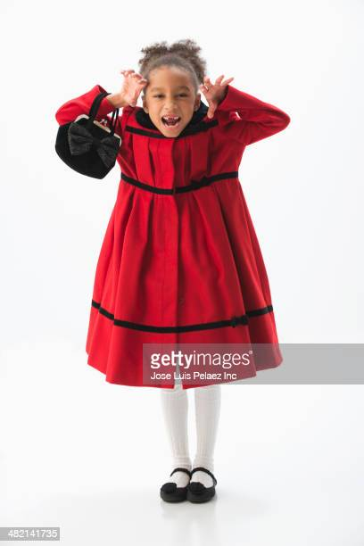 mixed race girl growling in dress coat - frock coat stock pictures, royalty-free photos & images