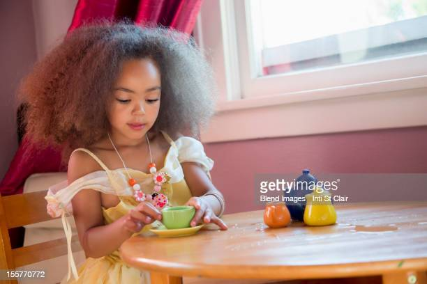 mixed race girl having tea party - tea party stock pictures, royalty-free photos & images
