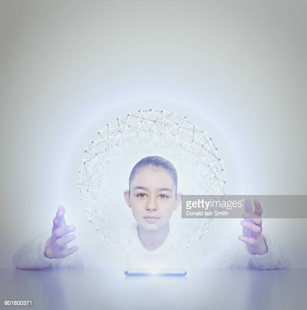 Mixed race girl holding sphere from digital tablet